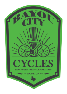Bayou City Cycles green logo with bike drawn on front in black print
