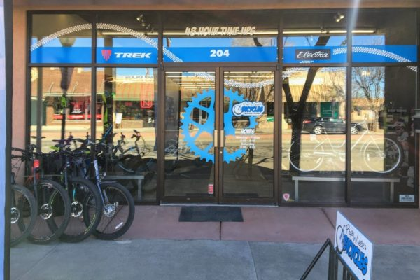 Front glass doors of Papa Wheelies, a Montrose bike shop