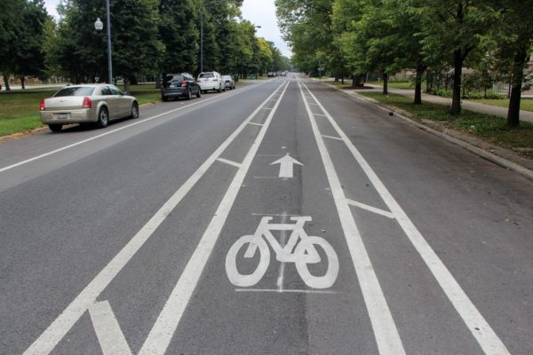Painted bike marks the center of a bike lane on a straight road running through North lawndale Chicago