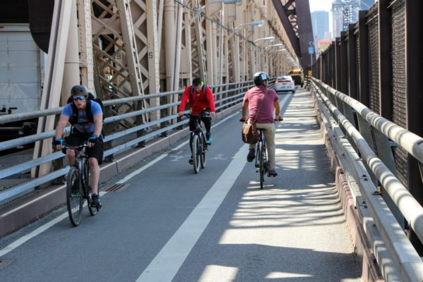 New Amsterdam cyclists bike across bridge in New York City